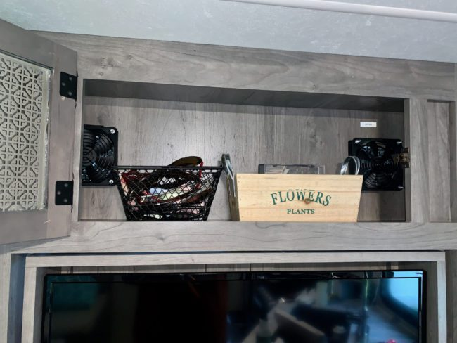 Upper Cabinet In Entertainment Center of Coachmen Apex 215RBK With Fans Installed